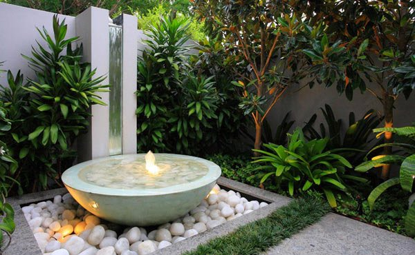 20 water feature designs for soft touch in your garden for Water feature design