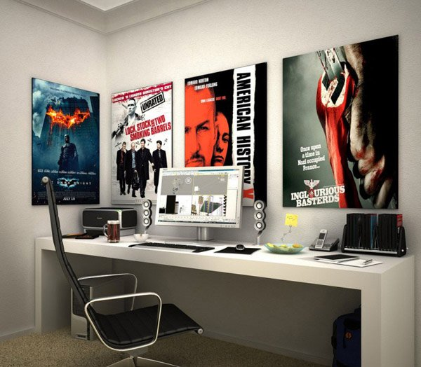 simple long desk is used for this work area. The movie posters added ...