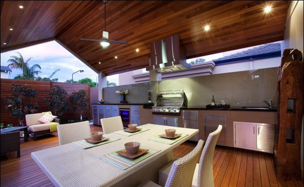 An Outdoor Kitchen With Wooden Touches For The Floor And Ceiling Its