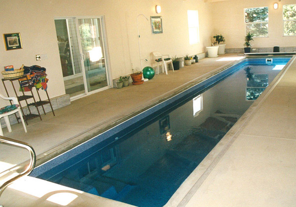 15 fascinating lap pool designs home design lover for Indoor swimming pool design uk