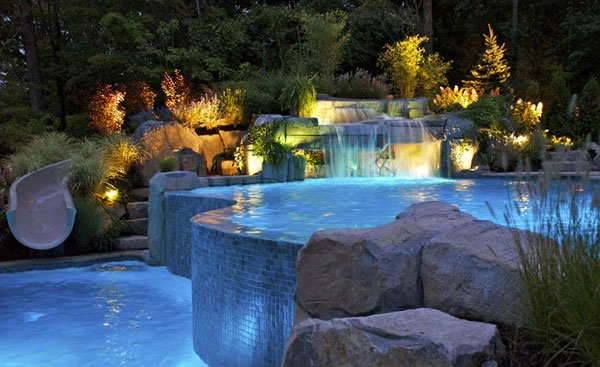 Inground Pools With Waterfalls 15 pool waterfalls ideas for your outdoor space | home design lover