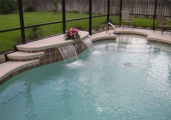 15 waterfall pool designs you can follow for your homes for Residential swimming pool designs