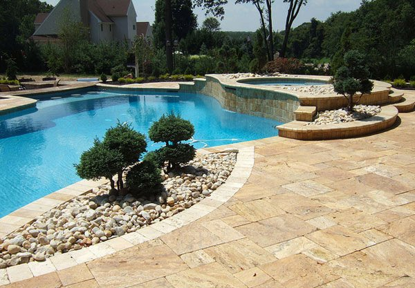 15 pool landscape design ideas home design lover for Pool landscaping ideas