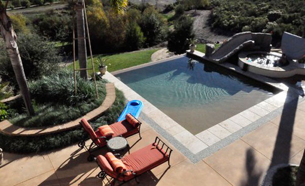 15 amazing backyard pool ideas home design lover for Pool design with slide