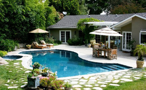 Tropical backyards with a pool home designer for Backyard swimming pool designs