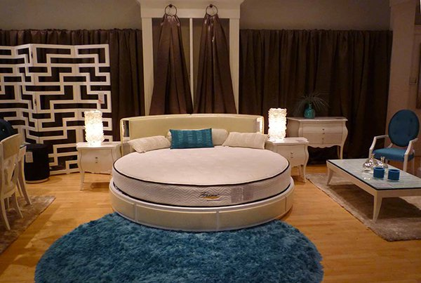circular shape of this bed adds symmetry and splendor to a bedroom