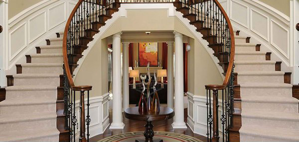 traditional staircase is perfect for a grand-entrance. The double ...
