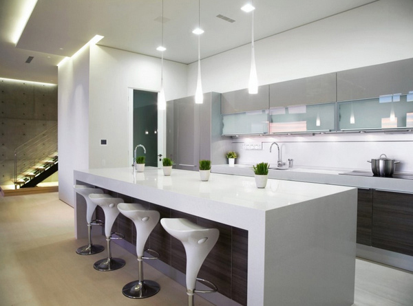 the dropping pendant lighting in this kitchen reminds us of tears that