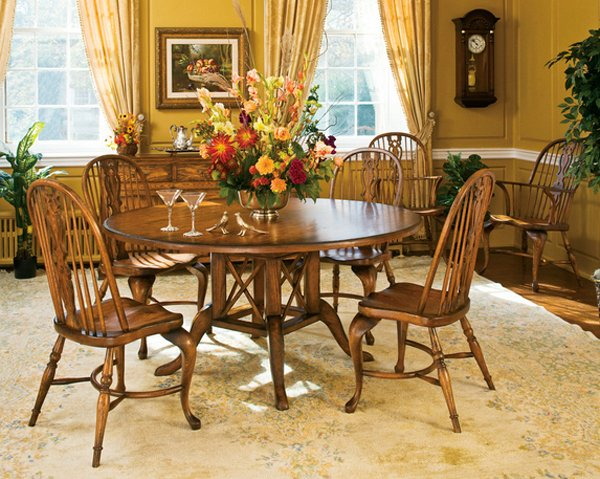 15 stunning round dining room tables home design lover for Quality wood dining tables