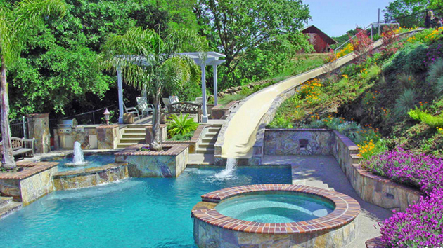 Pools luxury pools garden pools custom pools luxury backyards - 15 Gorgeous Swimming Pool Slides Home Design Lover