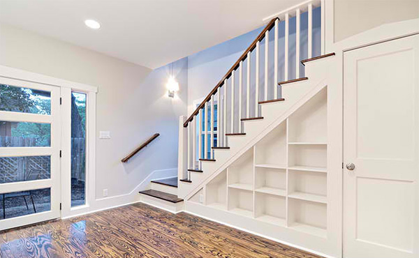 15 ideas for space saving under staircase shelves home for Pre built stairs interior