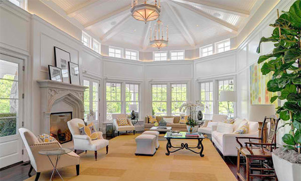 The color palette of this living room is so relaxing! Its high ceiling ...