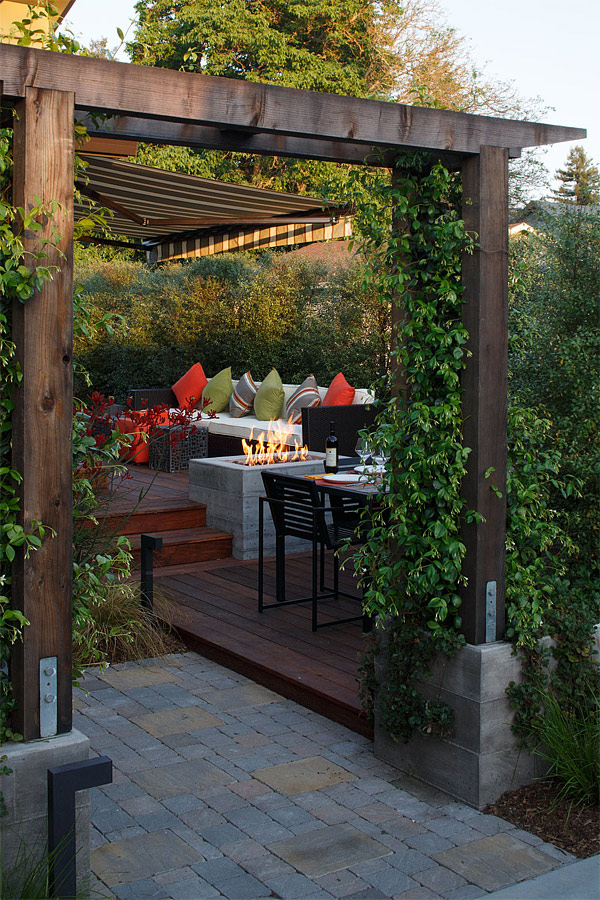 An outdoor dining with a fire pit looks like a nice area to unwind