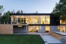 Modest Home that Cantilevers Along Dunrobin River in Canada