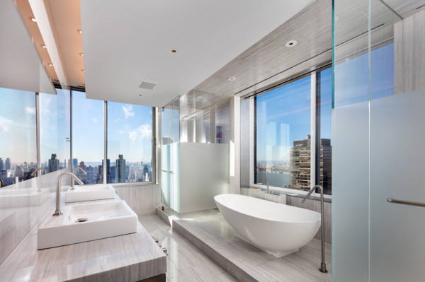 another bathroom in the penthouse has a sleek slender bath tub that