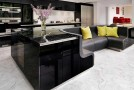 A High-Gloss Stylish Kitchen Island with Built-in Sofa