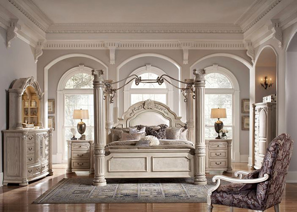 carved four-poster bed