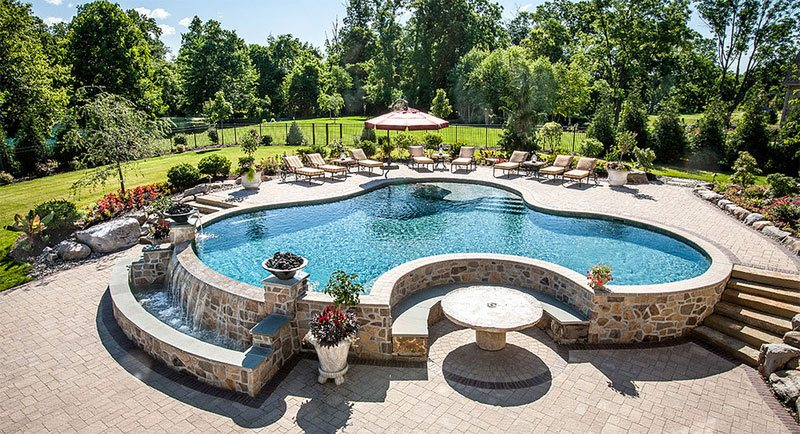 20 landscaping ideas for above ground swimming pool home for Raised pool designs