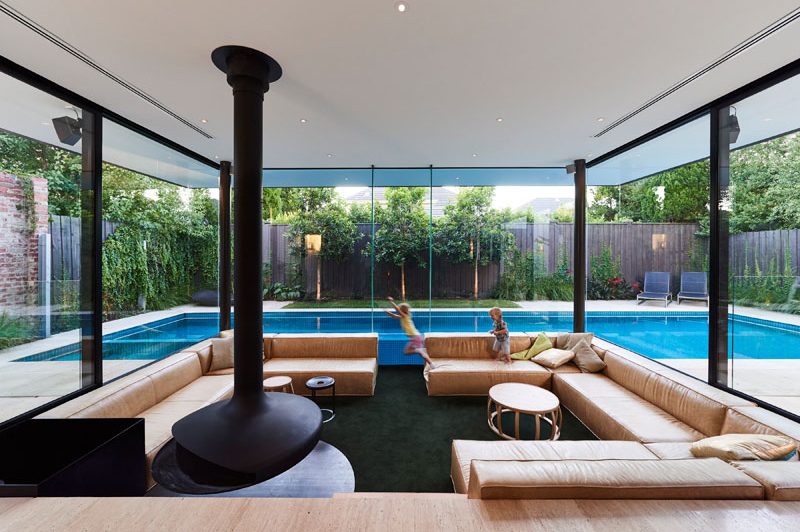 Swimming Pool House Featuring A Sunken Living Room Home