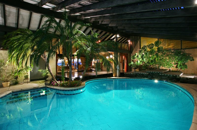 20 beautiful swimming pool landscaping with trees home for Tropical pools