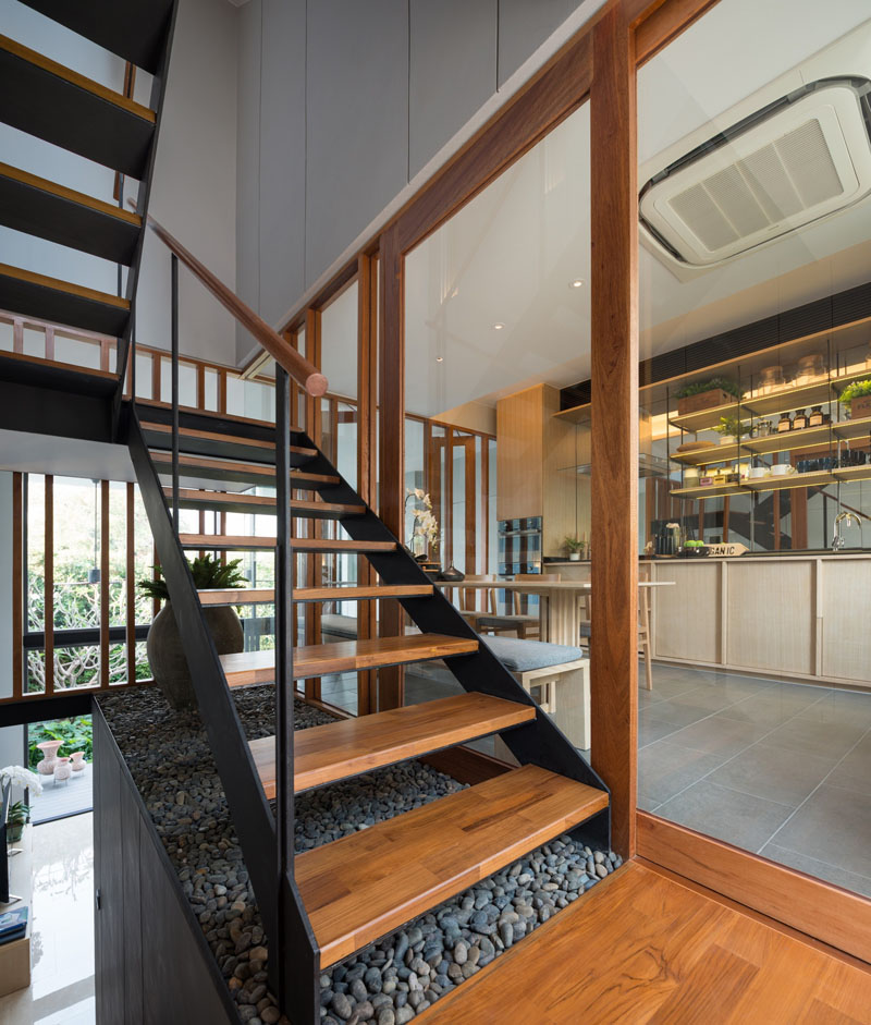 8-wood-and-steel-stairs Modern Interior Design Of Townhouse In Thailand on garden apartment interior design, modern townhouse bathroom, home interior design, small narrow room interior design, forms as elements of design, townhouse facade design, contemporary townhouse design, modern park design, modern exterior design, living room interior design, small house interior design, contemporary interior design, row house interior design, paris apartment interior design, new york apartment interior design, laundry room interior design, antique interior design, townhouse architectural design, kitchen interior design, townhouse exterior design,