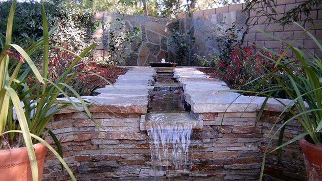 20 water feature designs for soft touch in your garden for Water landscape design