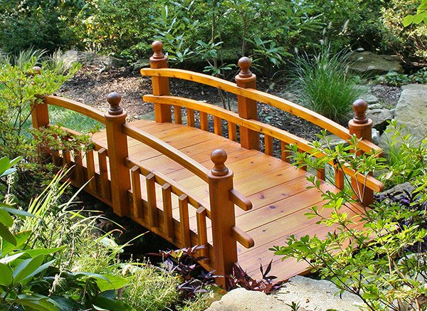 15 whimsical wooden garden bridges home design lover for Fish pond bridges