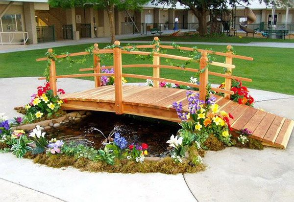 15 whimsical wooden garden bridges home design lover for Decorative fish pond bridge