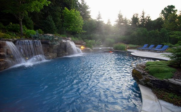 15 waterfall pool designs you can follow for your homes for Luxury inground pools