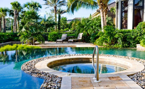 15 pool landscape design ideas home design lover for Swimming pool landscape design ideas
