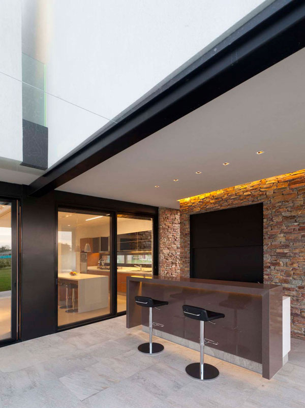 The modern design of a house in buenos aires argentina for Mini bar inside house
