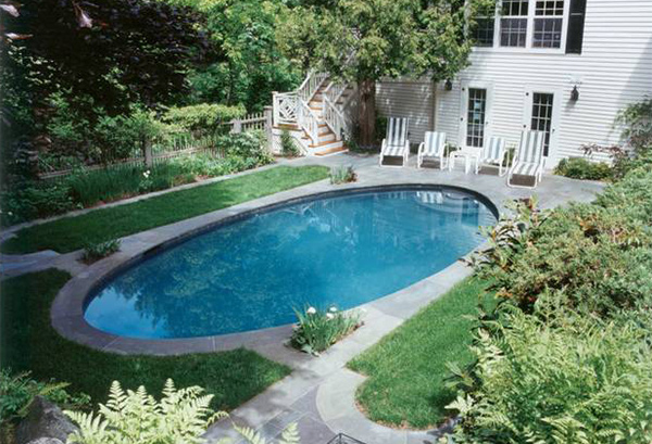15 lovely oval pool designs home design lover for Oval swimming pool