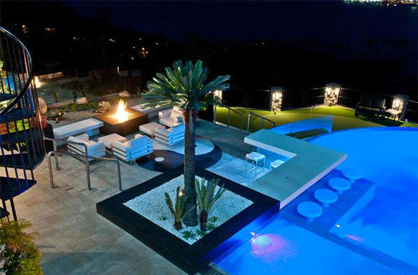 15 dramatic modern pool areas with fire pits home design - What do dreams about swimming pools mean ...