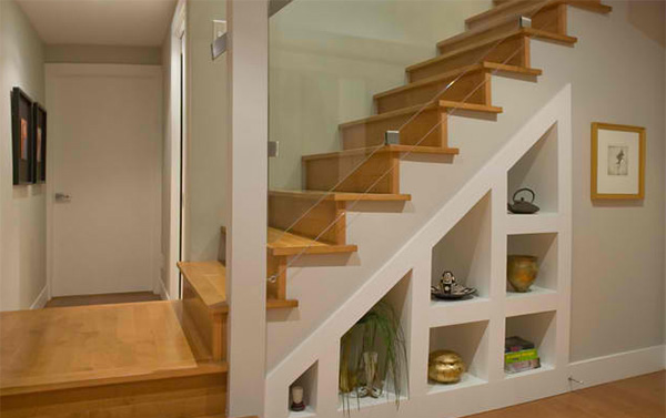 15 ideas for space saving under staircase shelves home for Under the stairs cabinet