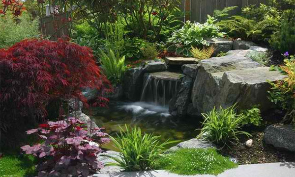 15 pond landscaping designs for your garden home design for Landscaping around koi pond