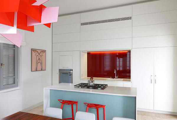 Use one color for walls and cabinetry