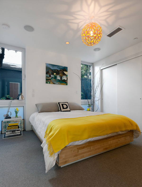 Yellow accents to bedroom