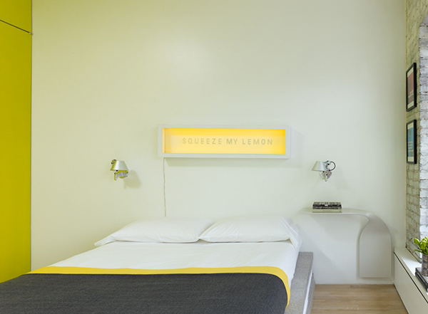 Yellow Green and white combination on limited space with modern bed lamps and customised bedside table.