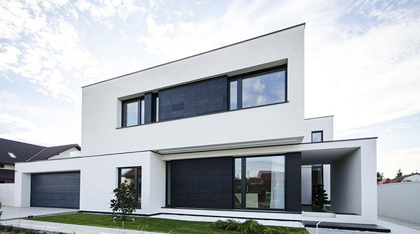 C house black and white volumes in a modern home in romania home design lover for Black and white house exterior
