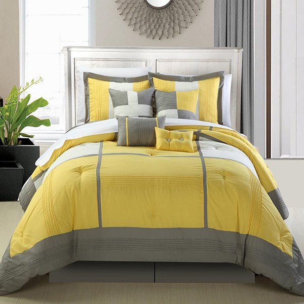 gray and yellow bed cover