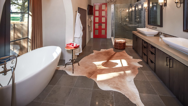 20 lovely ways cowhide and sheepskin rugs adorn a bathroom home rh homedesignlover com
