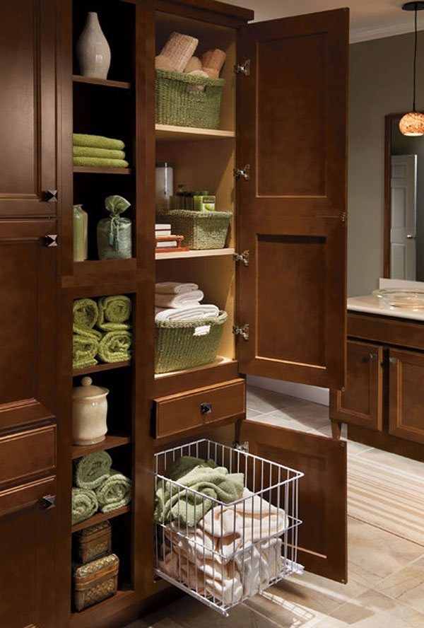 20 clever designs of bathroom linen cabinets home design lover for Tall bathroom storage cabinet with laundry bin