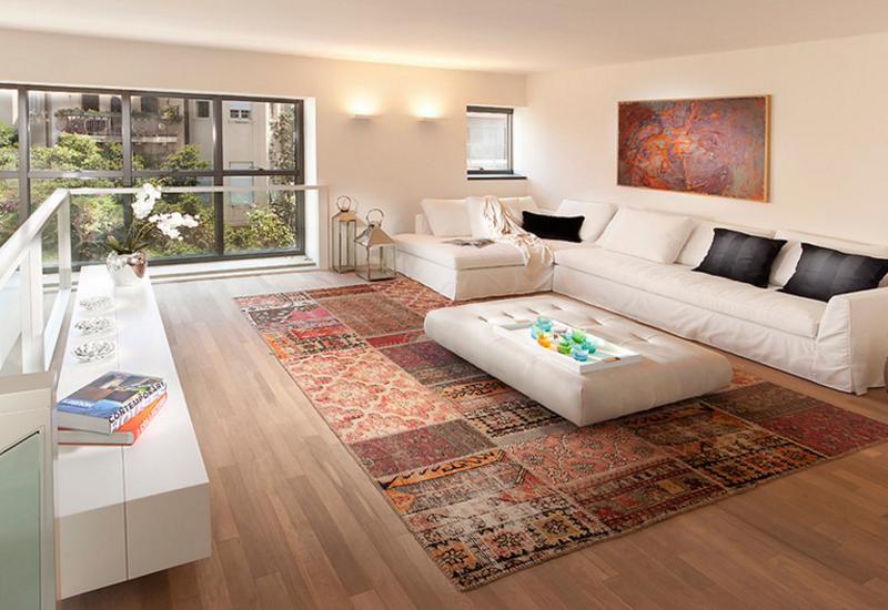 Arrange furniture on a rug properly