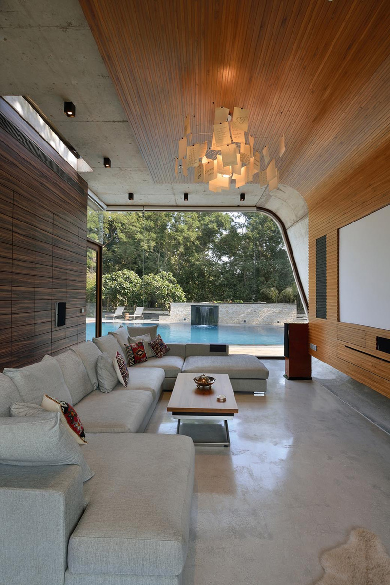 a curved concrete contemporary pool house in india home design lover