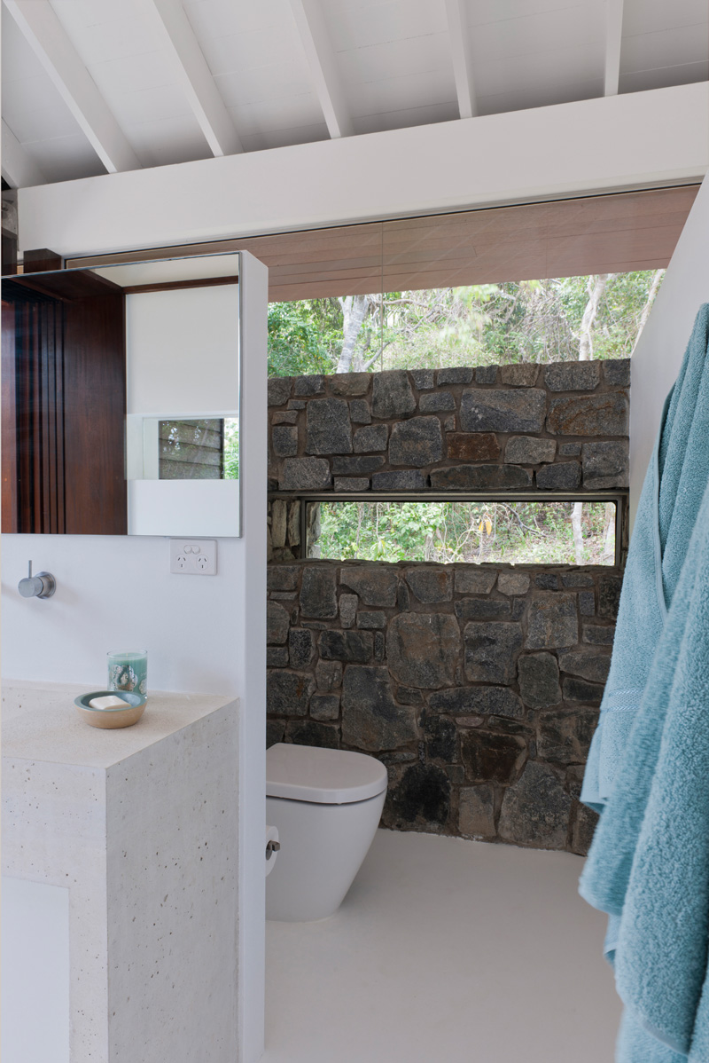 tropical beach house stone wall