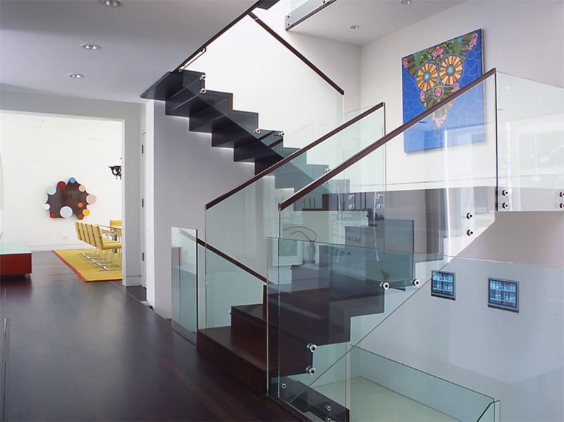 22 sleek glass railings for the stairs home design lover for Square spiral staircase plans hall