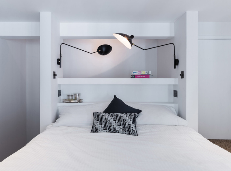 White Bed with black and white lamps over the bed
