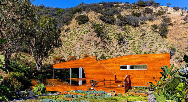 wood clad home green roof