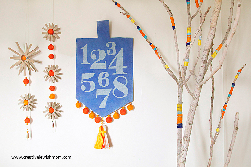 Hanukkah Craft: Eight Nights Stenciled Dreidel Wall Hanging