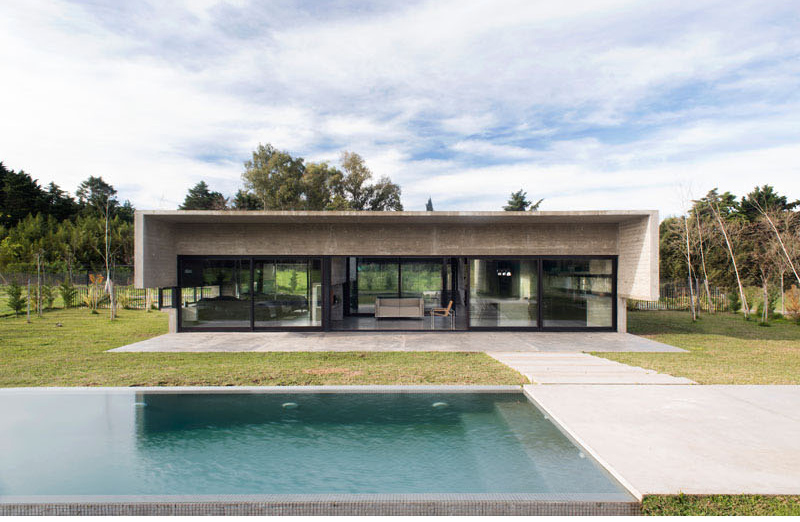 Concrete modern mach house in argentina home design lover for Pool design for mac